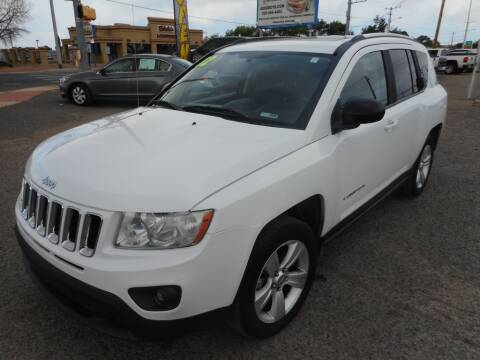 2012 Jeep Compass for sale at AUGE'S SALES AND SERVICE in Belen NM