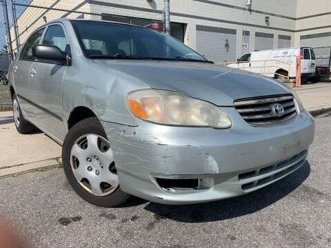 2004 Toyota Corolla for sale at Illinois Auto Sales in Paterson NJ