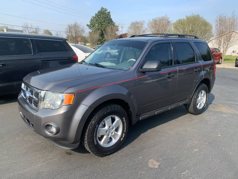 2011 Ford Escape for sale at Getsinger's Used Cars in Anderson SC