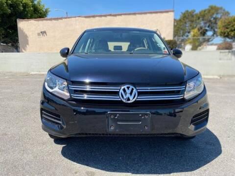 2014 Volkswagen Tiguan for sale at MAGNA CUM LAUDE AUTO COMPANY in Lubbock TX