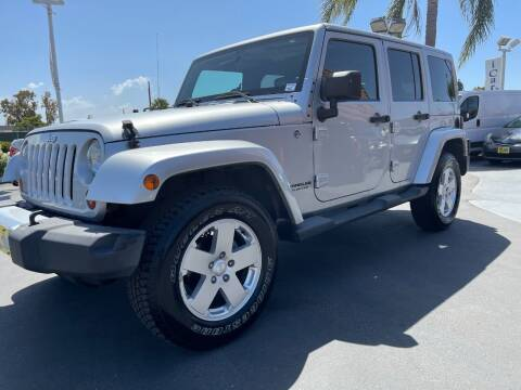 2012 Jeep Wrangler Unlimited for sale at CARSTER in Huntington Beach CA