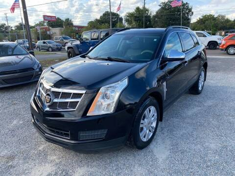 2011 Cadillac SRX for sale at Velocity Autos in Winter Park FL