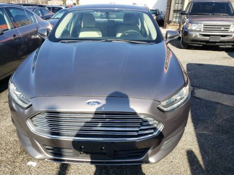 2014 Ford Fusion Hybrid for sale at Jimmys Auto INC in Washington DC