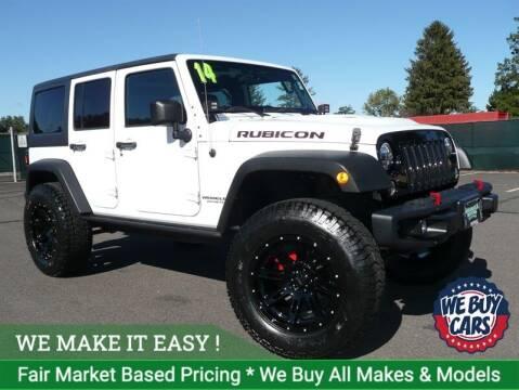 2014 Jeep Wrangler Unlimited for sale at Shamrock Motors in East Windsor CT