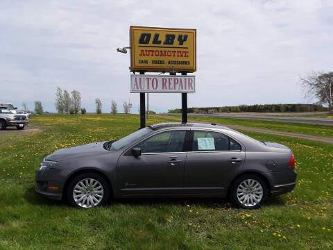2011 Ford Fusion Hybrid for sale at OLBY AUTOMOTIVE SALES in Frederic WI