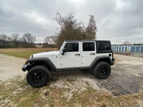 2013 Jeep Wrangler Unlimited for sale at Tennessee Valley Wholesale Autos LLC in Huntsville AL