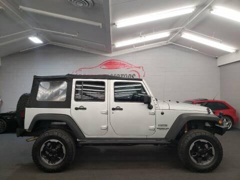 2010 Jeep Wrangler Unlimited for sale at Premium Motors in Villa Park IL