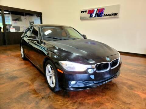 2012 BMW 3 Series for sale at Driveline LLC in Jacksonville FL