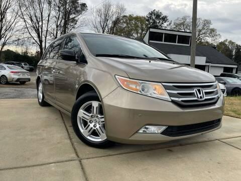 2012 Honda Odyssey for sale at Alpha Car Land LLC in Snellville GA