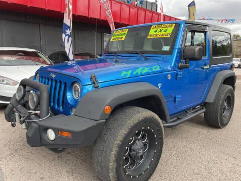 2015 Jeep Wrangler for sale at Duke City Auto LLC in Gallup NM
