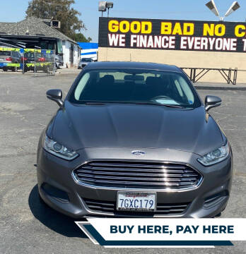 2014 Ford Fusion for sale at Global Auto Group in Fontana CA