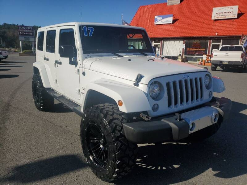 2017 Jeep Wrangler Unlimited for sale at Mulligan's Auto Exchange LLC in Paxinos PA