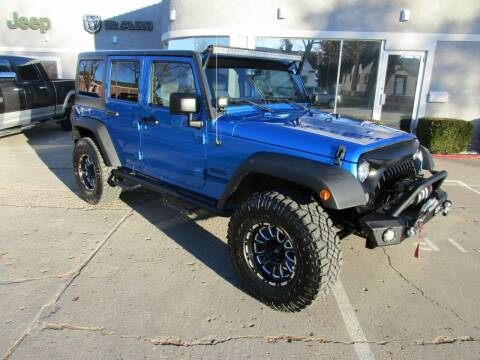 2015 Jeep Wrangler Unlimited for sale at West Motor Company in Preston ID