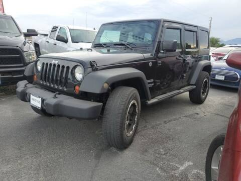 2012 Jeep Wrangler Unlimited for sale at INVICTUS MOTOR COMPANY in West Valley City UT