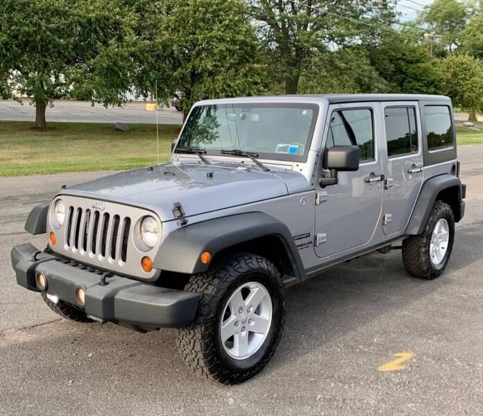 2013 Jeep Wrangler Unlimited for sale at Blum's Auto Mart in Port Orange FL