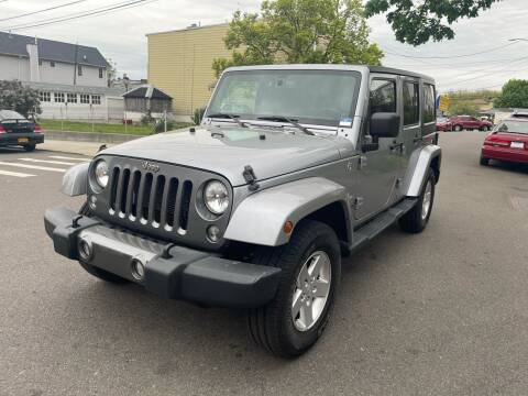 2014 Jeep Wrangler Unlimited for sale at Kapos Auto, Inc. in Ridgewood NY