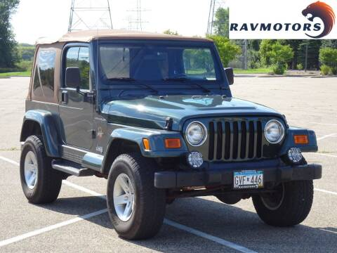 2002 Jeep Wrangler for sale at RAVMOTORS in Burnsville MN