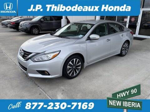 2017 Nissan Altima for sale at J P Thibodeaux Used Cars in New Iberia LA