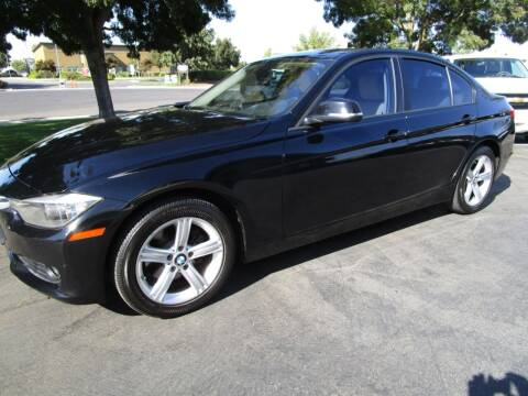 2012 BMW 3 Series for sale at KM MOTOR CARS in Modesto CA