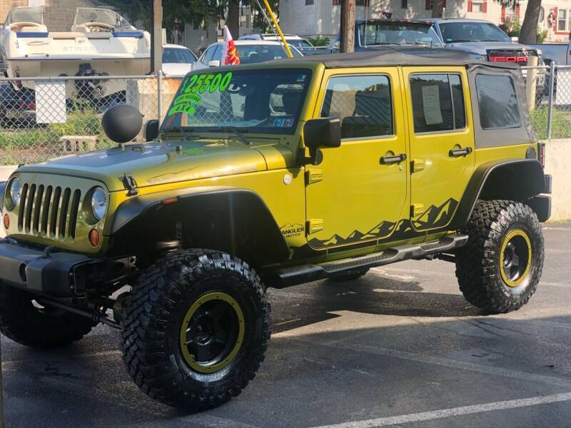 2010 Jeep Wrangler Unlimited for sale at Ginters Auto Sales in Camp Hill PA