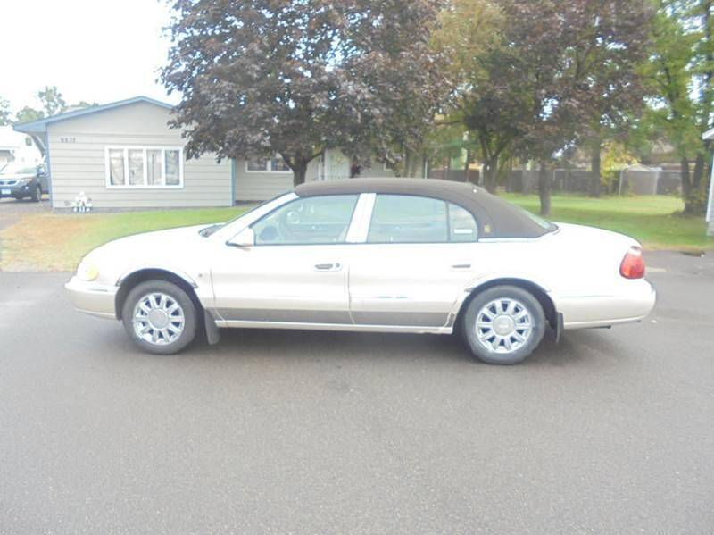 1999 Lincoln Continental for sale at Engels Autos Inc in Ramsey MN