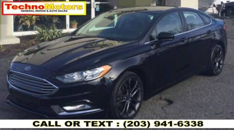 2017 Ford Fusion Hybrid for sale at Techno Motors in Danbury CT