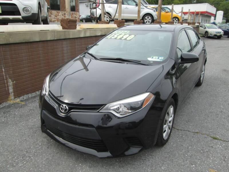 2014 Toyota Corolla for sale at WORKMAN AUTO INC in Pleasant Gap PA