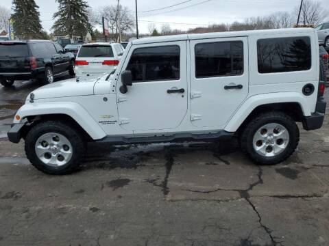 2014 Jeep Wrangler Unlimited for sale at Drive Motor Sales in Ionia MI