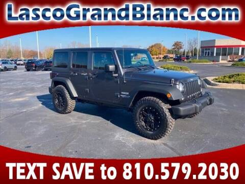 2017 Jeep Wrangler Unlimited for sale at Lasco of Grand Blanc in Grand Blanc MI