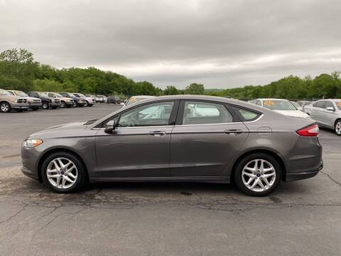 2014 Ford Fusion for sale at CARS PLUS CREDIT in Independence MO
