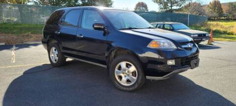 2005 Acura MDX for sale at BOOST MOTORS LLC in Sterling VA