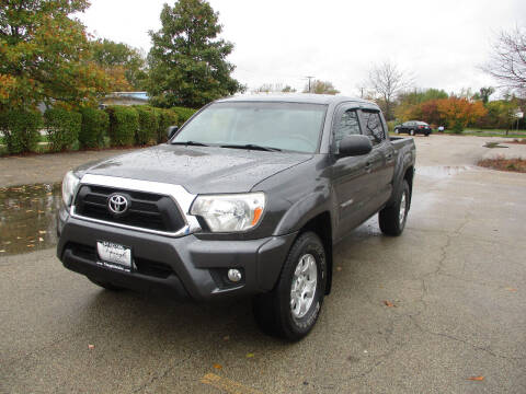 2014 Toyota Tacoma for sale at Triangle Auto Sales in Elgin IL