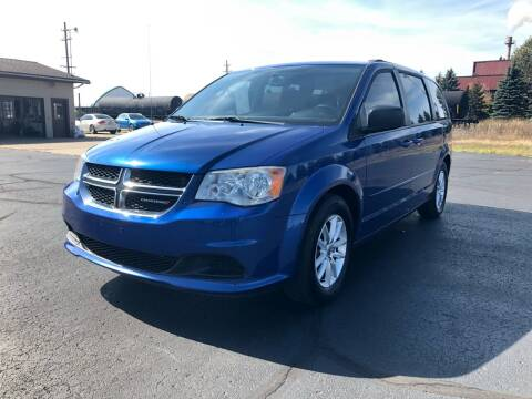 2013 Dodge Grand Caravan for sale at Mike's Budget Auto Sales in Cadillac MI