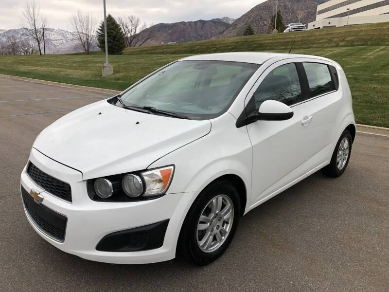2013 Chevrolet Sonic for sale at DRIVE N BUY AUTO SALES in Ogden UT