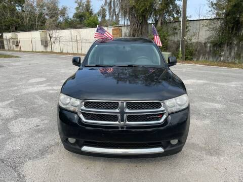 2012 Dodge Durango for sale at Louie's Auto Sales in Leesburg FL
