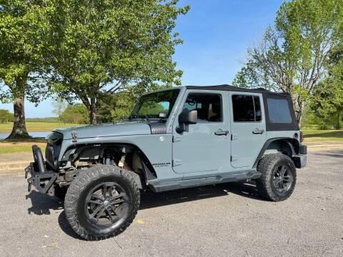 2014 Jeep Wrangler Unlimited for sale at LAMB MOTORS INC in Hamilton AL