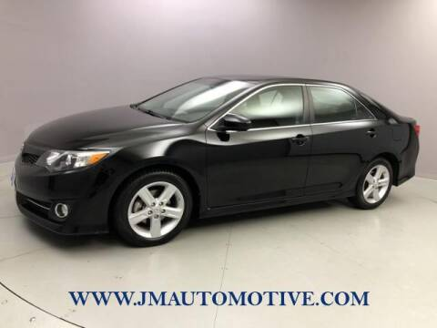 2014 Toyota Camry for sale at J & M Automotive in Naugatuck CT