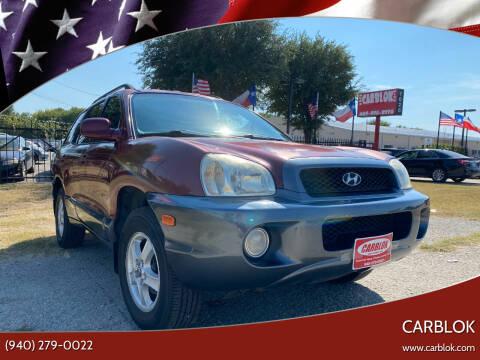 2002 Hyundai Santa Fe for sale at CARBLOK in Lewisville TX