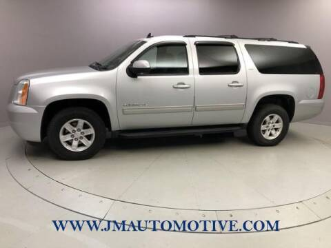 2013 GMC Yukon XL for sale at J & M Automotive in Naugatuck CT
