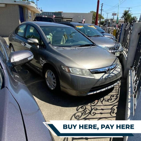 2006 Honda Civic for sale at ZOOM CARS LLC in Sylmar CA