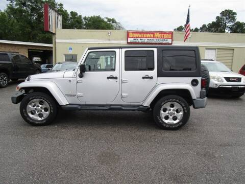 2009 Jeep Wrangler Unlimited for sale at DERIK HARE in Milton FL