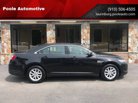 2014 Ford Taurus for sale at Poole Automotive in Laurinburg NC