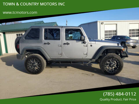2013 Jeep Wrangler Unlimited for sale at TOWN & COUNTRY MOTORS INC in Meriden KS