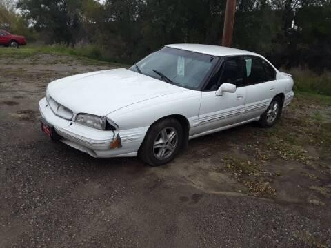 1999 Pontiac Bonneville for sale at BARNES AUTO SALES in Mandan ND