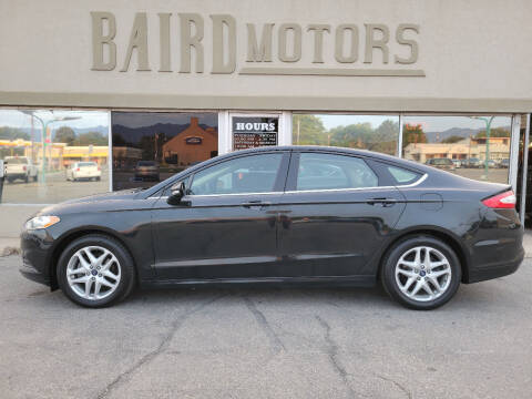 2014 Ford Fusion for sale at BAIRD MOTORS in Clearfield UT