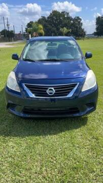 2014 Nissan Versa for sale at AM Auto Sales in Orlando FL