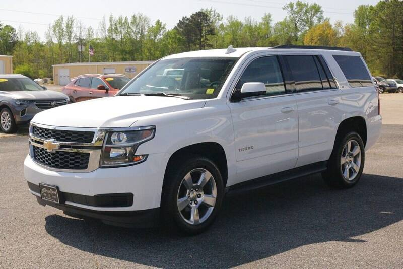 2016 Chevrolet Tahoe for sale at STRICKLAND AUTO GROUP INC in Ahoskie NC