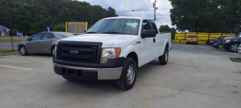 2013 Ford F-150 for sale at DADA AUTO INC in Monroe NC