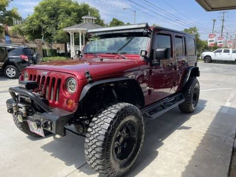 2013 Jeep Wrangler Unlimited for sale at Los Compadres Auto Sales in Riverside CA