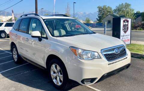 2014 Subaru Forester for sale at The Car-Mart in Murray UT